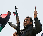 BENGHAZI, LIBYA, 20-03-2011..JUBILANT FIGHTERS AND RESIDENTS ON TOP OF A TANK ABANDONED BY GADAFFI'S FORCES, AFTER YESTERDAY'S ATTEMPT TO TAKE THE CITY. THE PRIZE WAS PARADED THROUGH THE STREETS, ACCOMPANIED BY CHANTING AND CELEBRATORY GUNFIRE..20-3-2011 PIC BY IAN MCILGORM.*****NB REX NO BYLINE*****