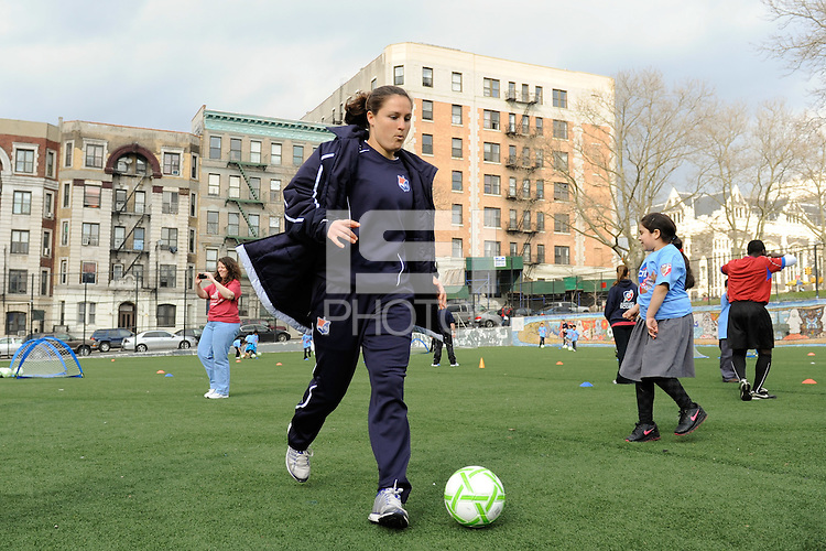 Kendall Fletcher of Sky Blue FC dribbles the ball.  during a Women's Professional Soccer (WPS) soccer clinic at PS 192 in Harlem, NY, on April 7, 2011.