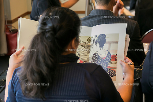 A woman looks at a shunga paint during a press conference to promote ''Shunga'', an exhibition of Japanese erotic art, at the Foreign Correspondents Club of Japan on May 21, 2015, Tokyo, Japan. The exhibition is organized with the collaboration of museums in Japan, Britain and other European countries, and showcases 120 shunga paintings which will be displayed together for the first time. Shunga is a Japanese erotic art, which was produced between 1600 and 1900, and continues to influence manga, anime and Japanese tattoo art. The actual exhibition will be held from September 19th to December 23rd at the Eisei-Bunko Museum. (Photo by Rodrigo Reyes Marin/AFLO)