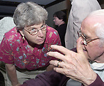 Audrey Tiernan and Tom Maguire talking at office party on October 10, 2000. Photo by Jim Peppler