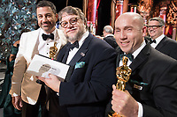Host, Jimmy Kimmel poses with Guillermo del Toro and J. Miles Dale, Oscar&reg;  winner for best motion picture of the year for work on &ldquo;The Shape of Water&rdquo; during the live ABC Telecast of The 90th Oscars&reg; at the Dolby&reg; Theatre in Hollywood, CA on Sunday, March 4, 2018.<br /> *Editorial Use Only*<br /> CAP/PLF/AMPAS<br /> Supplied by Capital Pictures