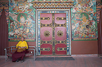A Holy man sitting and praying in a temple at Buddha Nath, Nepal