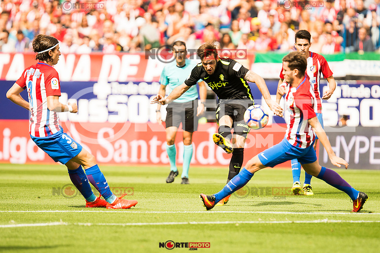 Atletico de Madrid's player Filipe Luis and Sporting de Gijon's player Burgui during a match of La Liga Santander at Vicente Calderon Stadium in Madrid. September 17, Spain. 2016. (ALTERPHOTOS/BorjaB.Hojas) /NORTEPHOTO