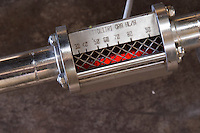 Detail of a filter, meter gage gauge showing the fluid flow measured in hectolitres per hour Bodega Del Anelo Winery, also called Finca Roja, Anelo Region, Neuquen, Patagonia, Argentina, South America