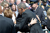 United States President Barack Obama comforts families of falling police officer at the National Peace Officers Memorial Service, an annual ceremony honoring law enforcement who were killed in the line of duty in the previous year, at the US Capitol in Washington, DC, May 15, 2015. <br /> Credit: Olivier Douliery / Pool via CNP