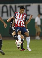 ba76c0b6c CD Chivas forward Sergio Santana (21) shields the ball. DC United defeated  CD
