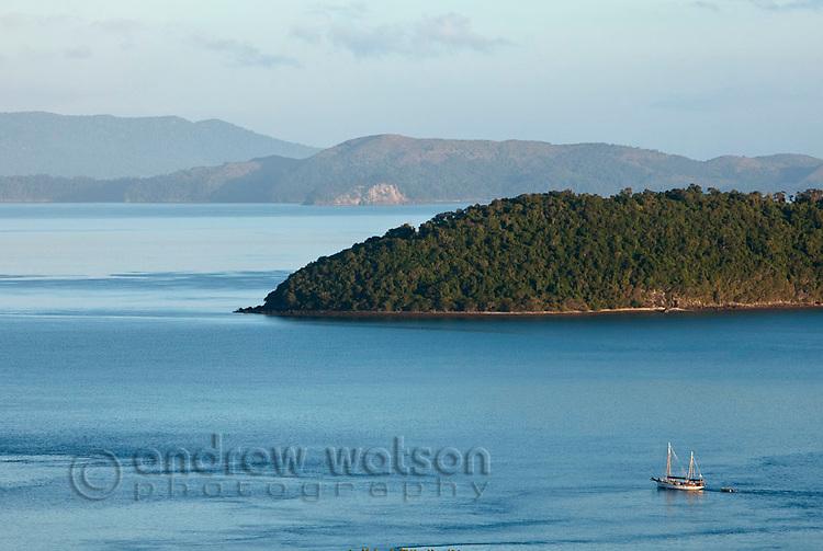 Sailboat cruising the Whitsunday Islands.  Whitsundays, Queensland, Australia