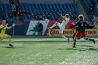 FOXBOROUGH, MA - MARCH 7: Przemyslaw Frankowski #11 of Chicago Fire chased down  a ball as Brad Knighton #18 of New England Revolution comes to save during a game between Chicago Fire and New England Revolution at Gillette Stadium on March 7, 2020 in Foxborough, Massachusetts.