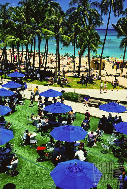 "The once a month """"Brunch on the Beach"""" in Waikiki on Kalakaua Avenue with picnic tables set up with local entertainment and food."