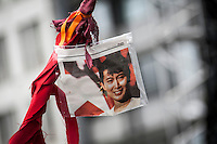 Supporters hold a poster of the Burmese pro-democracy leader AUNG SAN SUU KYI at a public meeting outside of the Nobel Centre in Oslo. Suu Kyi holds her first official diplomatic tour in Europe after 15 years in house arrest in Myanmar. She visits Switzerland, Norway, Ireland, Britain and France from June 13 to June 29 2012..