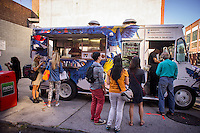 The Arepas food truck serving Columbian food in the Brooklyn neighborhood of Dumbo during the annual Art Under the Bridge Dumbo Arts Festival on Saturday, September 28, 2013.  Dumbo has been a neighborhood shared by industry and artists but high real estate prices have created opportunities for development with the subsequent increase in rents.  (© Richard B. Levine)