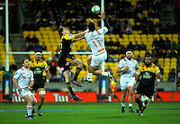 Beauden Barrett and James Lowe go up foir high ball during the Super Rugby semifinal match between the Hurricanes and Chiefs at Westpac Stadium, Wellington, New Zealand on Saturday, 30 July 2016. Photo: Dave Lintott / lintottphoto.co.nz