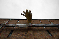 Adam Kurtzman's 11-foot golden Divine Hand sculpture on the side of the Jim Rouse Visionary Center at the American Visionary Art Museum.