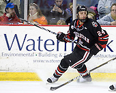 Drew Daniels (Northeastern - 24) - The visiting Northeastern University Huskies defeated the University of Massachusetts-Lowell River Hawks 3-2 with 14 seconds remaining in overtime on Friday, February 11, 2011, at Tsongas Arena in Lowelll, Massachusetts.