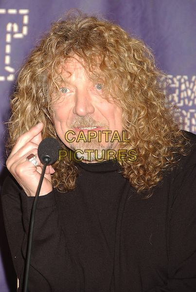 ROBERT PLANT.2008 CMT Music Awards held at Curb Center, Nashville, Tennessee, USA..April 14th, 2008.headshot portrait goatee facial hair microphone funny face hand .CAP/ADM/LF.©Laura Farr/AdMedia/Capital Pictures.