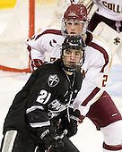 Chris Rooney (PC - 21), Brian Dumoulin (BC - 2) - The Boston College Eagles defeated the Providence College Friars 7-0 on Saturday, February 25, 2012, at Kelley Rink at Conte Forum in Chestnut Hill, Massachusetts.
