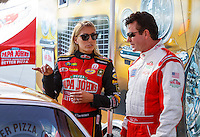 Sep 2, 2016; Clermont, IN, USA; NHRA top fuel driver Leah Pritchett (left) with Papa Johns pizza founder John Schnatter during qualifying for the US Nationals at Lucas Oil Raceway. Mandatory Credit: Mark J. Rebilas-USA TODAY Sports