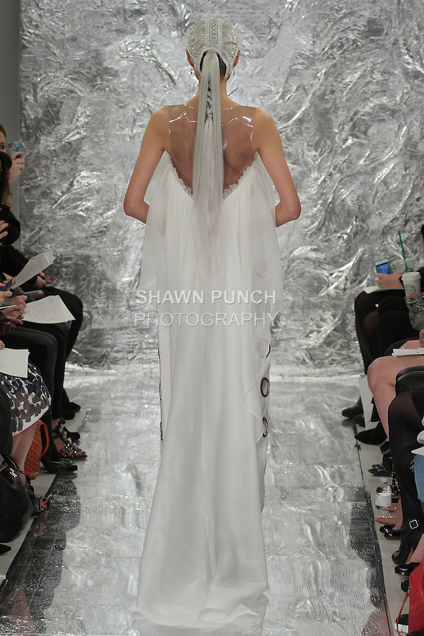 Model Shin Yang walks runway in Sabine - a white silke crepe and vinyl gown with stell grommets and silk organza ruffle bridal gown, from the Theia Spring 2017 bridal collection by Don O'Neill, during New York Bridal Fashion Week Spring Summer 2017 on April 14, 2016.