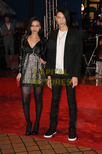 "LEAH & NAT WELLER .Attending the ""Red"" UK film premiere, .Royal Festival Hall, Southbank Centre, .London, England, UK, .19th October 2010..full length family brother sister siblings nathan black tights jacket dress leather tweed white t-shirt .CAP/CAS.©Bob Cass/Capital Pictures."