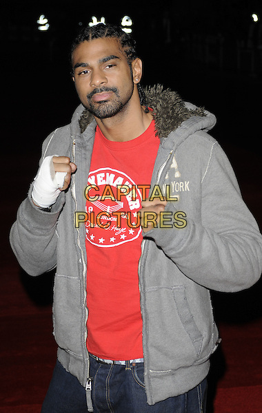 DAVID HAYE .attending the European Premiere of 'Harry Brown' at the Odeon Leicester Square, London, England, UK, November 10th 2009. .half length injured hand broken fist boxer boxing red t-shirt grey gray hoodie goatee facial hair injury hurt bandage pose hands fists pose posing .CAP/CAN.©Can Nguyen/Capital Pictures