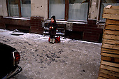 "Moscow, Russia<br /> Soviet Union<br /> December 10, 1991<br /> <br /> A young child, all dressed up for winter's cold, waits on the street.<br /> <br /> In December 1991, food shortages in central Russia had prompted food rationing in the Moscow area for the first time since World War II. Amid steady collapse, Soviet President Gorbachev and his government continued to oppose rapid market reforms like Yavlinsky's ""500 Days"" program. To break Gorbachev's opposition, Yeltsin decided to disband the USSR in accordance with the Treaty of the Union of 1922 and thereby remove Gorbachev and the Soviet government from power. The step was also enthusiastically supported by the governments of Ukraine and Belarus, which were parties of the Treaty of 1922 along with Russia.<br /> <br /> On December 21, 1991, representatives of all member republics except Georgia signed the Alma-Ata Protocol, in which they confirmed the dissolution of the Union. That same day, all former-Soviet republics agreed to join the CIS, with the exception of the three Baltic States."