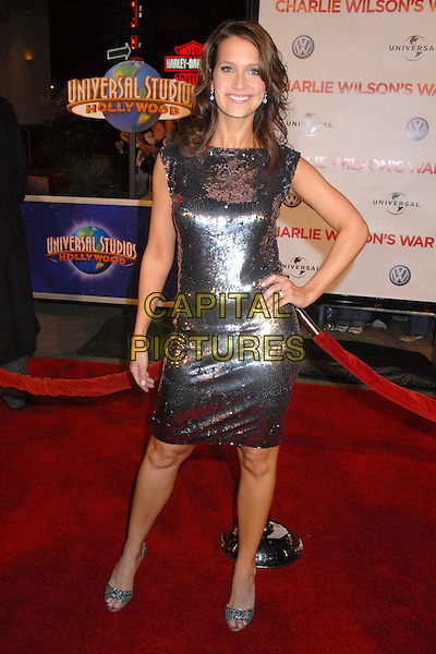 "HILARY ANGELO.""Charlie Wilson's War"" Los Angeles Premiere at Universal City Walk, Universal City, California, USA,.10 December 2007..full length grey silver sequined dress hand on hip.CAP/ADM/BP.©Byron Purvis/AdMedia/Capital Pictures."