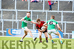 Denis Cronin Kenmare goes between Chris Davies and Denis Sheahan Legion during their Club Championship s/f in Fitzgerald Stadium on Sunday