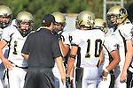 Manhattan Beach, CA 10/27/11 - Coach Chris Artino and Marco Catallo (Peninsula #10), Shane Scott (Peninsula #18) in action during the Peninsula vs Mira Costa Junior Varsity football game.