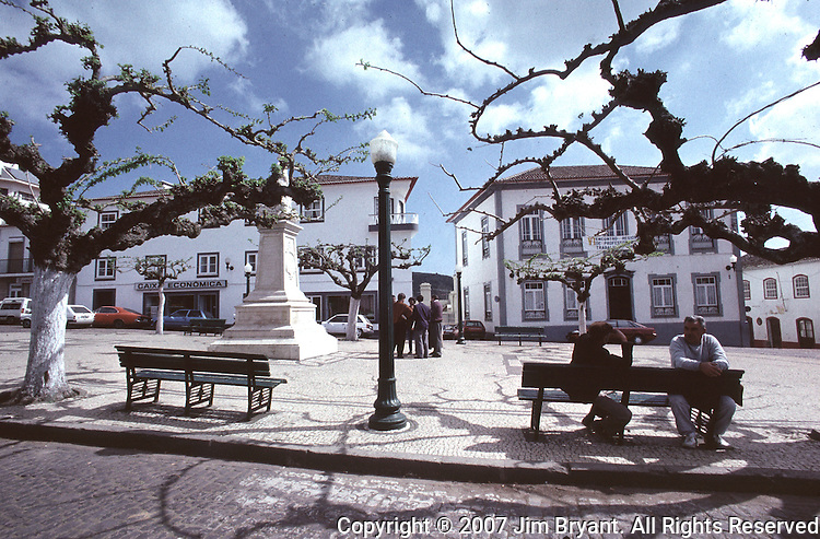 Town villages sit on a park bench in Praia's main square on Terceira, Azores. Far out in the Atlantic Ocean, some 850 miles off the western coast of Lisbon, Portugal lies the 425-mile long archipelago of the Azores. (Jim Bryant Photo).....