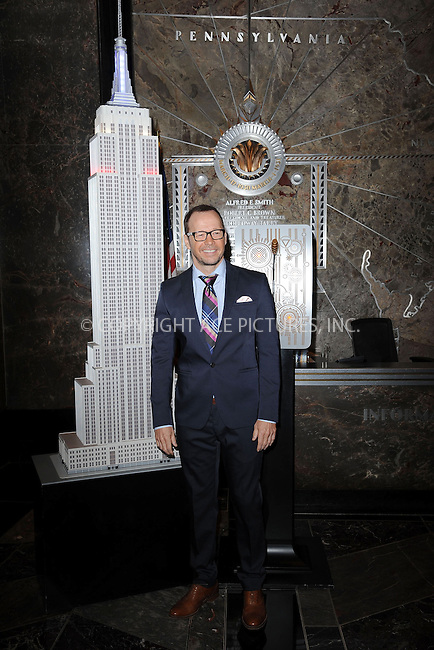 WWW.ACEPIXS.COM<br /> October 22, 2013 New York City<br /> <br /> Donnie Walhberg visits the Empire State Building on October 22, 2013.<br /> <br /> By Line: Kristin Callahan/ACE Pictures<br /> <br /> ACE Pictures, Inc.<br /> tel: 646 769 0430  or 212 243 8787<br /> Email: info@acepixs.com<br /> www.acepixs.com<br /> <br /> Copyright: Kristin Callahan/ACE Pictures