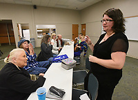 NWA Democrat-Gazette/FLIP PUTTHOFF <br /> AROMATIC OILS<br /> Sallyann Brown (from left) and Laurie Allen hear Kristin Jones with the Rogers Public Library staff talk about fragrant oils on Tuesday March 12 2019 during a presentation on essential oils at the library. Jones gave the program on various oils and their uses, including lavender, francincense and lemon oil. The program was featured at the library's monthly Lunch and Learn gathering. Lunch and Learn takes place the second Tuesday of each month from noon to 1 p.m. Friends of the Rogers Public Library sponsor Lunch and Learn.