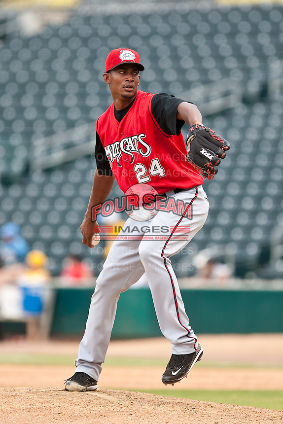 Jerry Gil (24) of the  Carolina Mudcats during a game vs. the Jacksonville Suns May 31 2010 at Baseball Grounds of Jacksonville in Jacksonville, Florida. Jacksonville won the game against Carolina by the score of 3-2. Photo By Scott Jontes/Four Seam Images