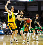 SIOUX FALLS, SD - MARCH 10: Marlon Stewart #1 of the North Dakota Fighting Hawks drives past Rocky Kreuser #34 of the North Dakota State Bison during the men's championship game at the 2020 Summit League Basketball Tournament in Sioux Falls, SD. (Photo by Richard Carlson/Inertia)