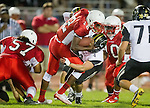 Lawndale, CA 09/26/14 - Chris Murray (Lawndale #12), Michael Joncich (Peninsula #4) and Matthew Ho (Peninsula #52) in action during the Palos Verdes Peninsula vs Lawndale CIF Varsity football game at Lawndale High School.  Lawndale defeated Peninsula 42-21