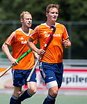 DEN HAAG - Floris Wotelboer in Oranje, tijdens de trainingswedstrijd Nederland-Argentinie (1-2).  links Erik Bouwens. COPYRIGHT KOEN SUYK