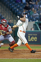 Zac Susi (45) of the Greensboro Grasshoppers follows through on his swing against the Hagerstown Suns at First National Bank Field on April 6, 2019 in Greensboro, North Carolina. The Suns defeated the Grasshoppers 6-5. (Brian Westerholt/Four Seam Images)