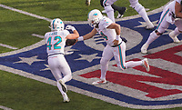 quarterback Ryan Fitzpatrick (14) of the Miami Dolphins und running back Patrick Laird (42) of the Miami Dolphins - 08.12.2019: New York Jets vs. Miami Dolphins, MetLife Stadium New York