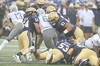 Annapolis, MD - September 8, 2018: Navy Midshipmen defensive end Marcus Edwards (93) and Navy Midshipmen linebacker Taylor Heflin (54) tackles Memphis Tigers running back Patrick Taylor Jr. (6) during the game between Memphis and Navy at  Navy-Marine Corps Memorial Stadium in Annapolis, MD.   (Photo by Elliott Brown/Media Images International)