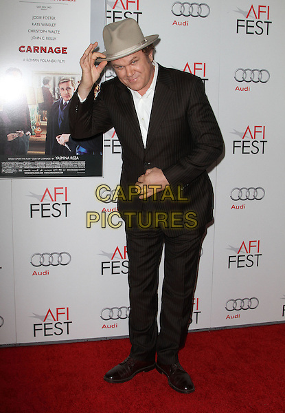 "John C. Reilly.AFI Fest 2011  Premiere Of ""Carnage"" Held At Grauman's Chinese Theatre, Hollywood, California, USA..November 5th, 2011.full length white suit hat beige brown black suit bending bow bowing .CAP/ADM/KB.©Kevan Brooks/AdMedia/Capital Pictures."