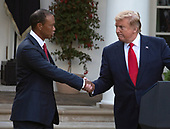 "United States President Donald J. Trump, right, shakes hands with professional golfer Tiger Woods, left, as he presents the Presidential Medal of Freedom to him in the Rose Garden of the White House in Washington, DC on May 6, 2019.  The Presidential Medal of Freedom is an award bestowed by the President of the United States to recognize those people who have made ""an especially meritorious contribution to the security or national interests of the United States, world peace, cultural or other significant public or private endeavor.""<br /> Credit: Ron Sachs / CNP"