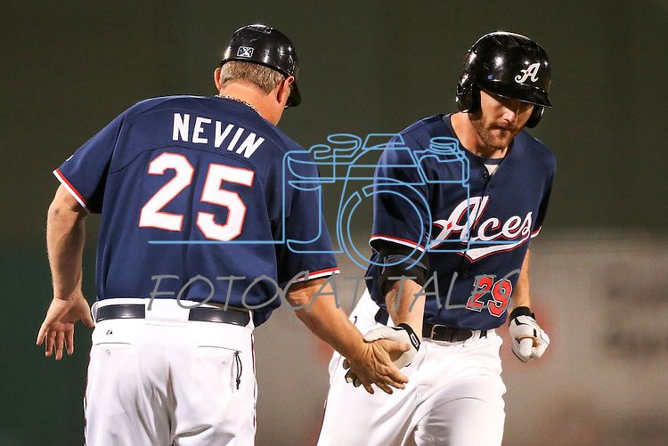 Reno Aces Manager Phil Nevin congratulates Roger Kieschnick after he homered against the Omaha Storm Chasers in a 5-2 victory on Wednesday, Aug. 27, 2014, in Reno, Nev.<br /> Photo by Cathleen Allison
