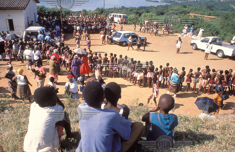 © Gisele Wulfsohn / Panos Pictures..Nr. Durban, SOUTH AFRICA..Teenage girls queue for virginity tests, a traditional Zulu ritual revived in recent years. Boys look on from a hillside vantage point.