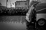 NEW YORK, NY - OCTOBER 28: Thousands of police officers from around the country stand in the rain for the funeral of slain NYPD Officer Randolph Holder at Greater Allen A.M.E. Cathedral of New York on October 28, 2015 in the Queens borough of New York City. Holder, 33, was gunned down while chasing a suspect in East Harlem last week, the fourth officer to be fatally shot in the line of duty in New York City in the last 10 months. Photo by Yunghi Kim/ Contact Press Images.
