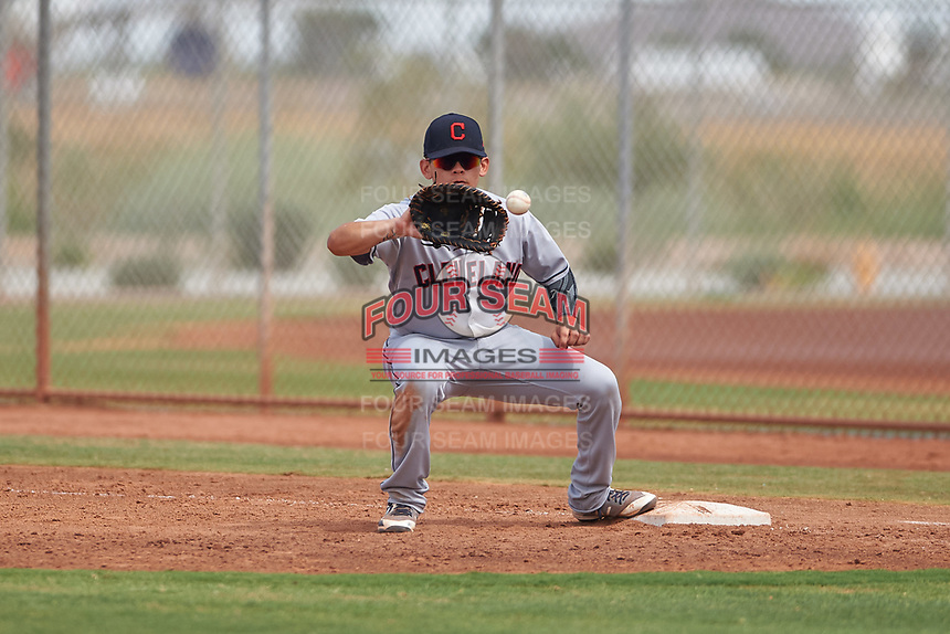 AZL Indians Red first baseman Joe Naranjo (24) catches a throw during an Arizona League game against the AZL Indians Blue on July 7, 2019 at the Cleveland Indians Spring Training Complex in Goodyear, Arizona. The AZL Indians Blue defeated the AZL Indians Red 5-4. (Zachary Lucy/Four Seam Images)