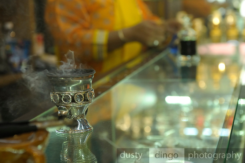 Shops selling rare and exotic fragrances are a feature of the Kampong Glam and Bugis areas of Singapore -- here Frankincense burns in a counter-top holder.