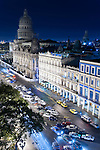 Havana, Cuba; a night scene of Central Park, the Capitol, the Gran Teatro, Hotel Inglaterra, Hotel Telegrafo and passing cars, viewed from the roof of the Parque Central Hotel