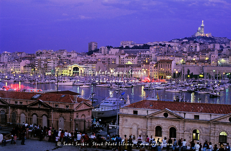Boats in the marina of the Vieux-Port with Notre Dame de la Garde in the background, Marseille, France.