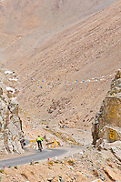 "Mountain biker at ""Siachen Toggler's Gate"" on the highest motorable road in the world,  Himalayan Mountains, Ladakh, India."