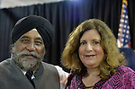 Seaford, New York, USA. 3rd June 2015. MOHINDER SINGH TANEJA of Salisbury, a Sikh and Indian community advocate, and MARIA BRENNAN of Wantagh, pose for a photo at Press Conference supporting extension of the NY Property Tax Cap. Earlier, BRENNAN introduced the Governor after she spoke to audience about how, prior to the tax cap, her taxes increased 10% in one year, and how high taxes are a concern to family members she'd like to join her in Long Island. At the bi-partisan event at Knights of Columbus Hall, over a hundred area residents and officials, and the governor, urged extending the property tax cap before the state legislative session ends on June 17. The NY Property Tax Cap is set to expire June 2016, but is legally linked to NYC rent-control regulations set to expire this month.