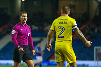 Referee Anthony Backhouse has a word with AFC Wimbledon's Barry Fuller during the Sky Bet League 1 match between Oldham Athletic and AFC Wimbledon at Boundary Park, Oldham, England on 21 November 2017. Photo by Juel Miah/PRiME Media Images